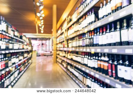 Abstract Blurred Image Of Liquor Shop For Background Uses