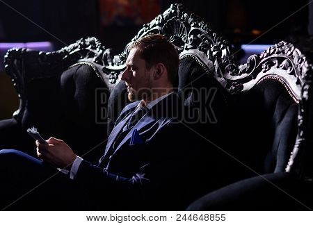 Rich Lifestyle, Professional Success, Profit, Finance Concept. Bearded Man With Confident Face Holds