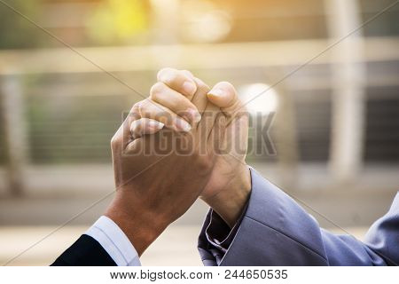 Closeup Of Two Hands Joining Together, Symbolizing To Trust Each Other.