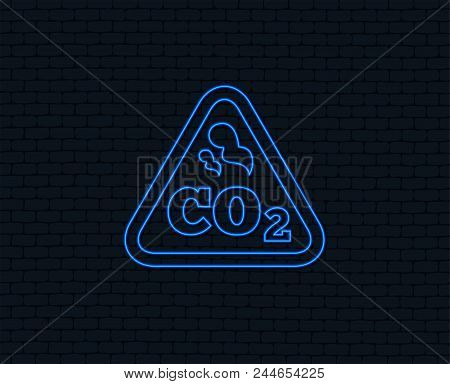 Neon light. CO2 carbon dioxide formula sign icon. Chemistry symbol. Glowing graphic design. Brick wall. Vector poster