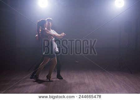 Active Happy Adults Dancing Bachata Together In Dance Class.