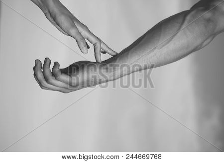 Relationship Between Man And Woman. Two Hands On Cloudy Blue Sky. Female Fingers Touching Male Arm S