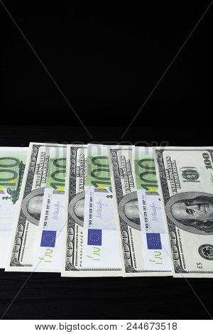 100 Euro And 100 Us Dollar Banknote For Background