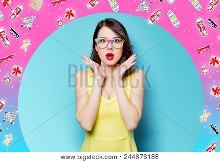 Portrait Of Beautiful Surprised Young Woman In Glasses On The Wonderful Blue Studio Background With