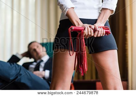 Sexy Female Legs With Sexy Toy And Man At Office Background