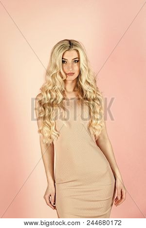 Girl In Sexy Fashionable Dress. Look And Fashion Style. Fashion Model Pose In Studio On Pink Backgro
