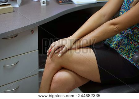 Pain In Knee. Close-up Office Worker Female Leg With Painful Knees. Woman Feeling Joint Pain, Having
