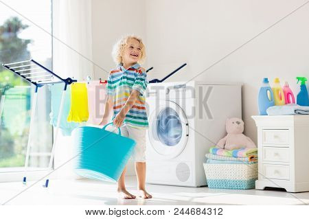 Child In Laundry Room With Washing Machine