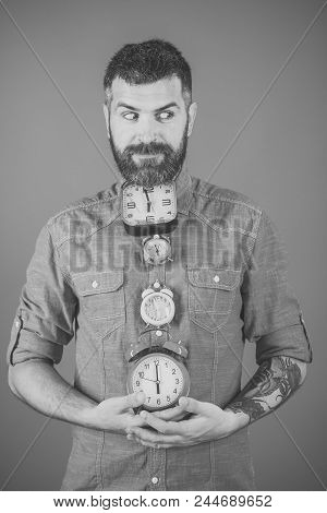 Time Fleeting. Time And Perfect Morning. Man With Beard Hold Alarm Clock. Overtime And Urgency. Time
