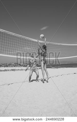 Beach Volleyball. Young Sporty Active Couple Beat Off Volley Ball, Play Game On Summer Day. Woman An
