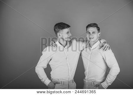 Friendship, Brotherly Custody. Happy Men Hugging. Models Standing Together. Family, Brotherhood And