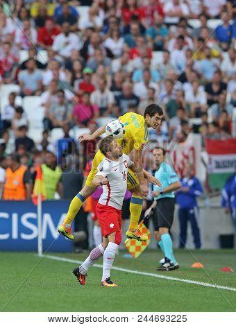 Marseille, France - June 21, 2016: Taras Stepanenko Of Ukraine (yellow) Fights For A Ball With Jakub