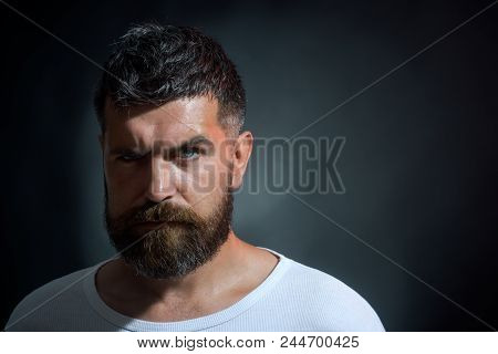 Man. Man Portrait. Confident Successful Male Model In T-shirt. Sporty Handsome Bearded Man With Seri