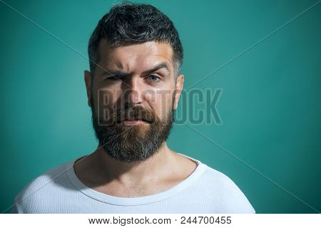 Handsome Serious Fashion Man Portrait. Portrait Of Charismatic Man With Beard&mustache In Casual T-s
