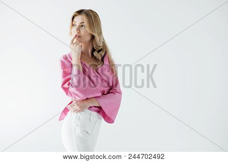 Portrait Of Attractive Pensive Woman In Pink Blouse Isolated On White