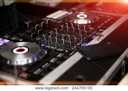 In Selective Focus Of Pro Dj Controller.the Dj Console Cd Mp4 Deejay Mixing Desk Ibiza House Music P