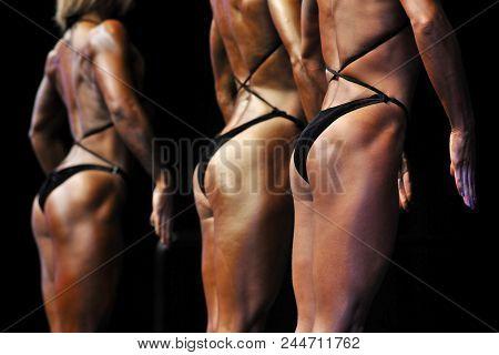 Woman To Compete In Fitness Bikini. Closeup Beautiful Female Bikini Buttocks