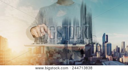 Double Exposure, A Man Using Digital Tablet, And Modern Buildings Hologram. Real Estate Business And