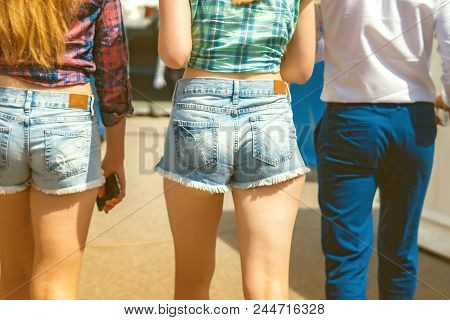 A Young Woman Is In Short Shorts, Big Ass