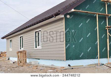 Kyiv, Ukraine - June, 20, 2018:  Building House With Wall Insulation, Waterpfoof Membrane, Plastic S
