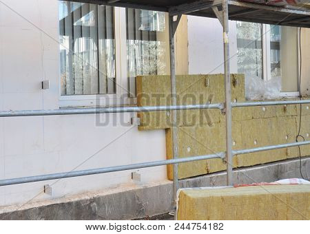 Rock Wall Insulation House With Insulation Material For Home Energy Saving. Installing Mineral Wool