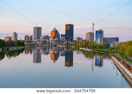 Rochester, Ny - May 14, 2018: Skyline Of Rochester, New York Along  Genesee River At Sunset