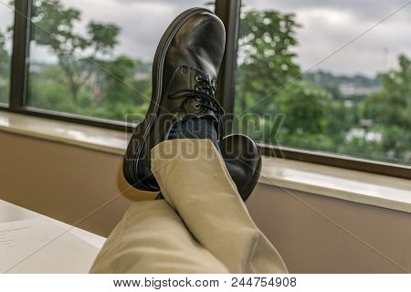 Feet Up At The Office Looking Out Window 1