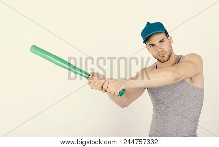 Sports And Baseball Training Concept. Guy In Grey Tank Top Holds Bright Green Bat. Man In Cyan Green