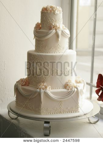 A Four-Tiered Wedding Cake At The Bakery