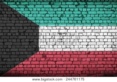 Kuwait Flag Is Painted Onto An Old Brick Wall