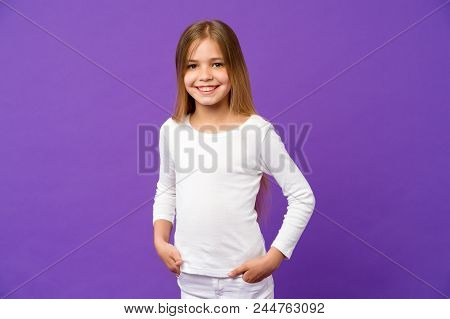 Small girl smile on violet background. Child smiling with long blond hair on purple background. Kid model in casual shirt. Fashion style and trend. Happy childhood and childcare. poster