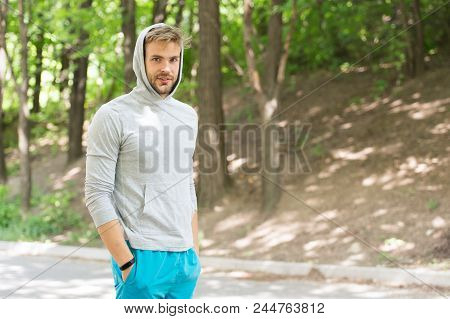 Taking Minute Break. Runner Workout Outdoor. Man Athlete With Hood After Running Outdoor, Nature Bac