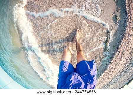 Feet In The Sea Water.