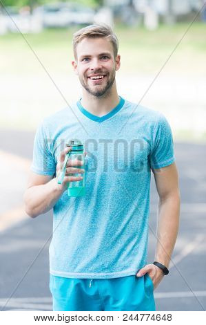 Drink Some Water. Man With Athletic Appearance Holds Water Bottle Man Athlete Sport Clothes Refreshi