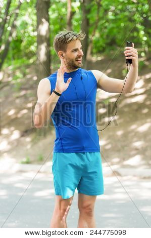 Glad To See You. Athlete Mobile Phone Video Call Before Running. Man Athlete Smiling Face Online Tra