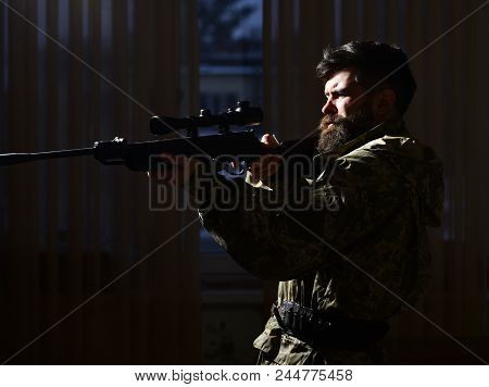 Macho On Suffering Grimace Face Aiming At Victim. Hunter, Soldier With Gun Aiming Before Shooting. S