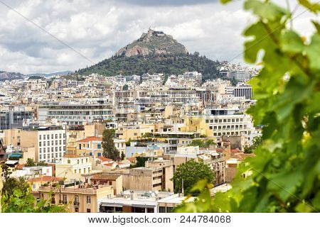 Scenic View Of Athens And Mount Lycabettus From The Acropolis Slope, Greece. Panorama Of Athens From