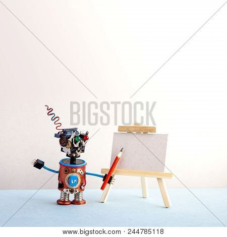 Kindly Robot Artist Begins To Create A Drawing With A Pencil. White Paper Template, Wooden Easel. Ad