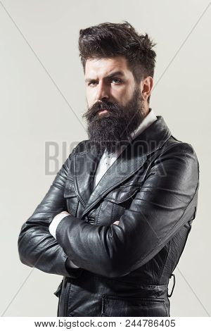 Barber Shop Concept. Fashion. Trendy Clothes. Bearded Man In Black Jacket. Leather Jacket. Advertisi