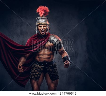 Brutal Ancient Greece Warrior With A Muscular Body In Battle Uniforms Screams In Battle Agony On A D