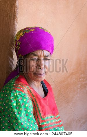Lesedi Cultural Village, SOUTH AFRICA - 4 November 2016: Thoughtful senior African woman in colourful traditional clothing