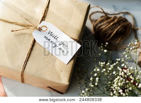 Gift box with a phrase will you marry me?