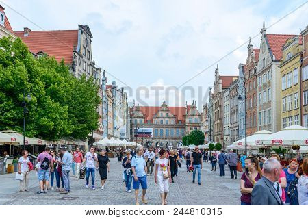 GDANSK - MAY 26: Tourists enjoy the sunny weather and walk at Long Market Square on 26 May 2018 in Gdansk, Poland. Gdansk is a city of Memory and Freedom on the UNESCO World Heritage list.