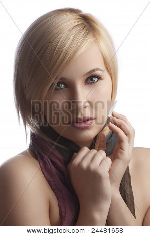 Portrait Of  Blond Girl With Beautiful Scarf Looking At The Camera