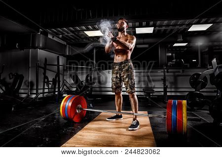 Young Athlete Man Ready For Weight Workout. Closeup Sport Of Weightlifter Clapping Hands Before Barb
