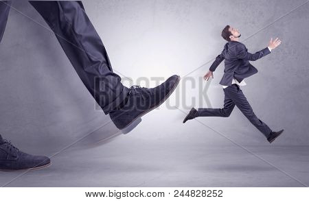 Deported from workplace, big foot kicking small businessman flying away