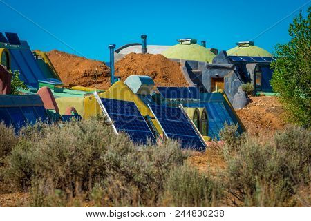 self sustainable living in energy efficient earthship high mountain desert Taos, New Mexico