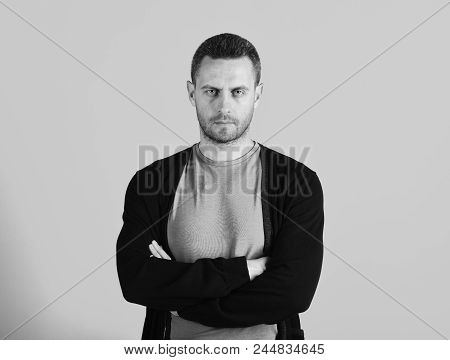 Man With Bristle Or Beard Holds Arms Crossed. Macho With Confident Face Expression And Athletic Post