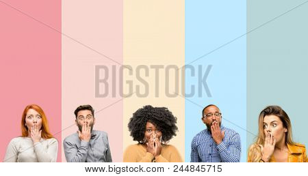 Cool group of people, woman and man covers mouth in shock, looks shy, expressing silence and mistake concepts, scared