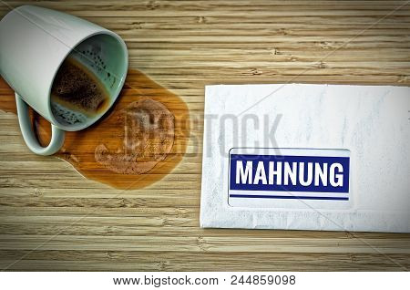Letter With In German Rechnung In English Bill And A Dumped Coffee Cup From Fright